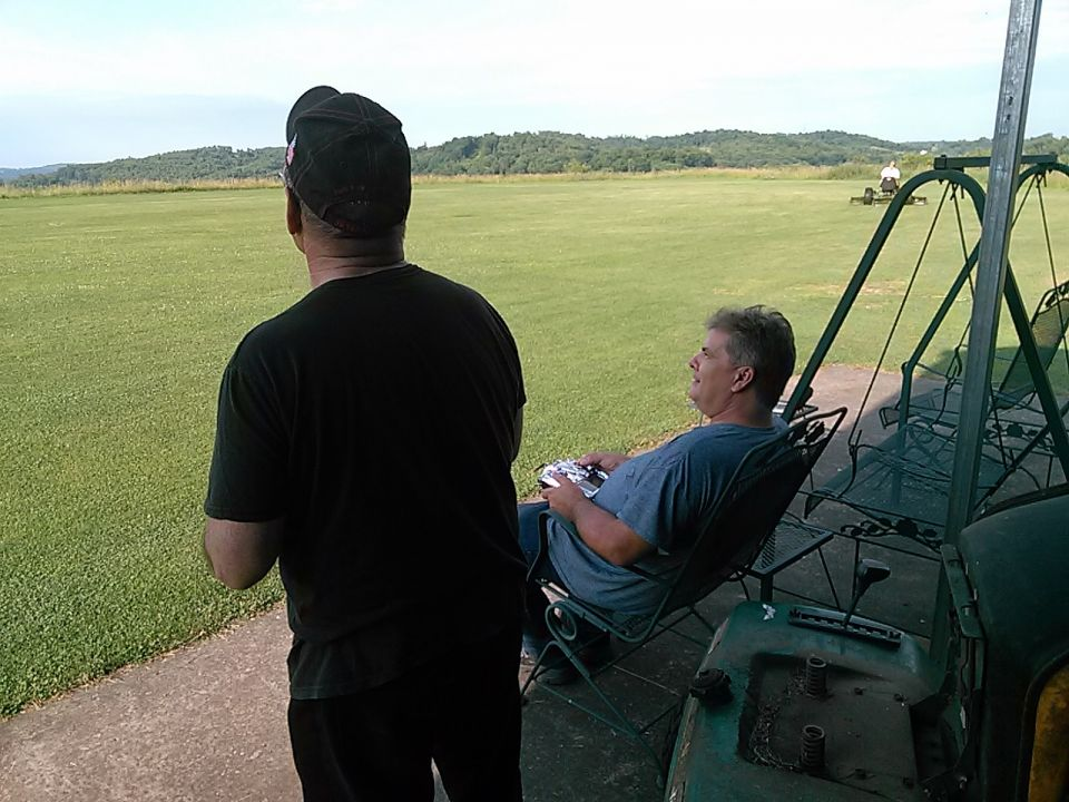 Bob and Jeff burning up the skies today. Nice weather again. Pooh cut the field again while we were flying. She loves the reel mowers and doesn't mind cutting with them. Me and Bill got them all fixed yesterday and they cut real good. We have the other one in maintenance. Pretty soon both will be cutting perfect and it will cut the time in half. The field is appx. 3 acres!